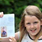 Little girl gets toy passport stamped
